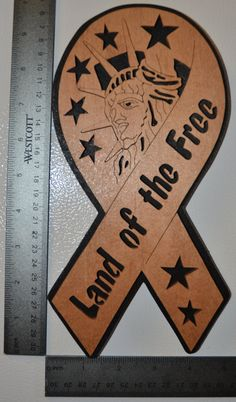 Land of the Free Ribbon Scroll Saw Wall Plaque on Etsy, $15.00