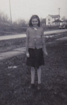 13 year old Beatrice. You can tell its the Depression, look how thin she is. Know where I got my skinny legs now.