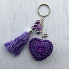 Crochet Heart and Handmade Beaded Tassel Keyring Bag Charm in Purple I have crocheted the heart in a purple cotton yarn. There is a purple flower button sewn on one side and a. Diy Hair Accessories, Crochet Accessories, Crochet Stitches, Crochet Patterns, Crochet Keychain Pattern, Crochet For Beginners, Sewing A Button, Crochet Gifts, Small Gifts