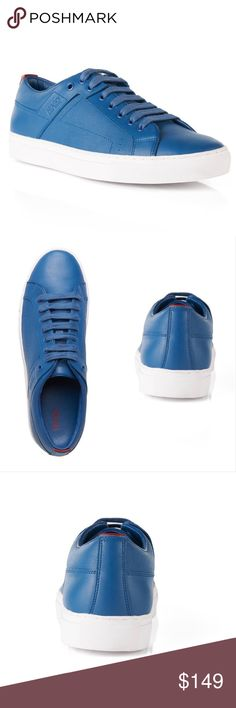 Men's Hugo Boss Leather Sneakers Hugo Boss Futesio-SF Leather Sneaker With Structured Sections Item #50310033 Blue  Condition: 100% Authentic with original packaging. Brand New, unworn.  Retail Price: $275  Material and care: Upper material: 100% Calfskin, Lining: 100% Polyester, 100% Calfskin, Sole: 100% Rubber  Fit and measurements: Euro - 42 UK - 8 USA - 9 Foot length (in c.m) - 27/27.2 Foot length (in i.n.) - 10.6/10.7 Hugo Boss Shoes Sneakers