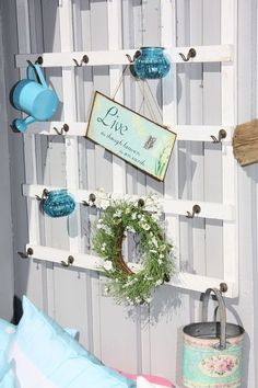 like the hooks on a trellis....could also grow a vine on an outside back wall.  good focal for potting shed area
