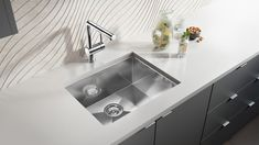 This sleek kitchen countertop demonstrates the quality of this Blanco stainless steel sink. The high-angle point of view allows us to see the details of this modern and sophisticated product. High Angle, Stainless Steel Sinks, Kitchen Countertops, 3 D, Kitchen Design, Design Inspiration, Modern, Home Decor, Homemade Home Decor
