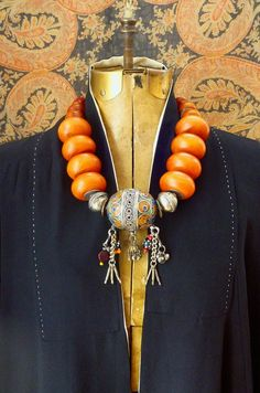 Necklace | Helena Nelson-Reed. 'Berber Queen'. Focal Berber bead (a contemporary rendition of the Taguemout , an enameled bead from Morocco's western Anti Atlas region) is combined with vintage mock amber resin beads made in Germany in the late 20th century.