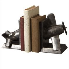 Refresh - Pure products for your home and body - Vintage Airplane Bookend , $49.99 (http://www.refreshgiftshop.com/vintage-airplane-bookend/)