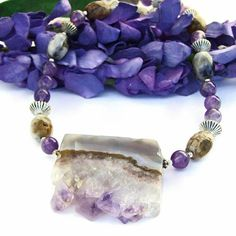 The ENCHANTED handmade necklace is filled with earthy goodness. Carefully created by Catherine of Shadow Dog Designs with a rough, natural amethyst agate geode slice used as a pendant, the one of a ki