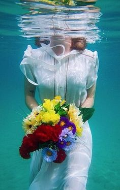 Underwater engagement photos are exactly as magical as they sound