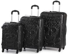 Just in time for Halloween! This cool spinner luggage set comes in red and white also. BOO!