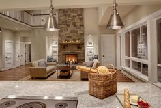 """view of 11ft island, and cooktop and pendants .Island solid 11' long slab of Kashmir White granite-polished. 13""""overhang at stools. Edge is eased and finished. Walls are painted BM white dove. Cabinets are 2.5"""". Walls are Stingray by Ben Moore. Turner Stool-Crate and Barrel."""