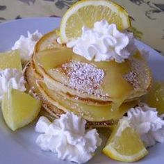 Lemon Cheesecake Pancakes~ omg! - To make low carb use - 8 ounces cream cheese, softened - 2 eggs, beaten - 5 teaspoons almond flour - 1 1/2 teaspoons Truvia - 2 teaspoons butter, melted - divided - sugar free confectioners' sugar for dusting - 1 teaspoon lemon juice - 1/2 lemon, cut into wedges