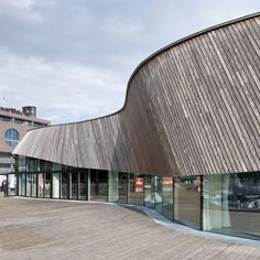 Image 1 of 19 from gallery of Aker Brygge / MAPT + Alliance arkitekter. Courtesy of Lendagar Arkitekter, Arcgency Scandinavian Architecture, Timber Architecture, Architecture Details, Library Architecture, Oslo, Wooden Facade, Restaurants, Timber Structure, Curved Walls