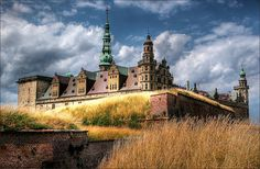 """Kronborg Castle, DENMARK. """"In Denmark there stands an old castle named Kronenburg…where Holger Danske sits in the deep, dark cellar, into which no one goes…""""  Hans Christian Andersen"""