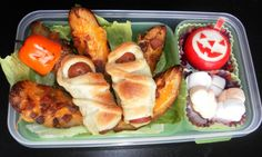 First Halloween Bento of the season!! Hot dog mummies being pulled into the salad underworld by a potato skin Anubis hand!! The pumpkins are a pepper, and a Gouda cheese, with a soul pit made of ghost shaped marshmallows! (Great part is, I chop up the pepper and toss in the tomatoes hiding under the Gouda pumpkin with the lettuce and my salad is complete!)