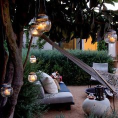 Wow - what could be a better backyard escape than this? Gorgeous outdoor fire pit area, perfectly enclosed with shrubs and these hanging candles in glass orbs. This is the perfect place for some fire-free Candle Impressions Flameless Candles so you can focus on having a good time, and not about the wind blowing out your candles or a fire starting