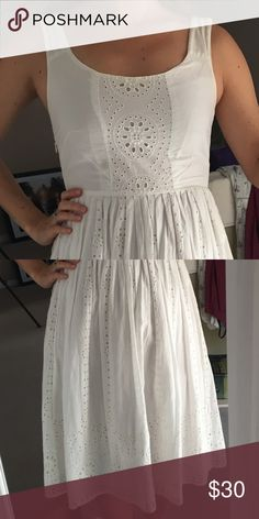 Delia's White Sundress This dress has a beautiful empire waist and flattering neckline. It has lots of eyelet details throughout the entire dress. It is lined on the skirt. There is a hidden zipper on one side. I can post more pics if necessary.   It is a size 4 but fits more like a 2.  It has some signs of wear, including very slight discoloring near the armpit 🙈 Dresses Midi
