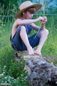 View top-quality stock photos of Young Boy Wearing Blue Overalls Sitting On Fallen Tree. Action Pose Reference, Human Poses Reference, Pose Reference Photo, Figure Drawing Reference, Body Reference, Action Poses, Sitting Pose Reference, Cool Poses, Kid Poses
