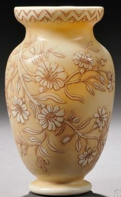 """Year: 1880 - 1920 A Thomas Webb & Sons Cameo glass vase, Stourbridge, England, late 19th to early 20th century, inverted baluster vase with flared mouth, decorated with cameo-cut flowers to body, [ivory ground], marked to underside """"THOMAS WEBB & SONS LIMITED"""" in a circular cartouche."""