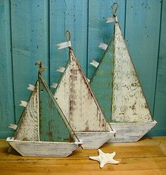 Sailboat Sign Wall Art Beach House Decor - Small Medium or Large by CastawaysHall  Fun beach house style decor. This is the weathered wood sailboat. Use them all year round; surround them with a seashell collection, add a bit of nautical decor to a bookshelf, string the lines with little lights at Christmas time.  This listing for your choice of a small, medium or large sailboat. Colours can be customized too.  These sailboats are made of a combination of thick wood from old doors and old…