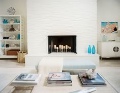 Amazingly gorgeous texture & pattern on the fireplace!   House of Turquoise: Eddie Lee Inc.