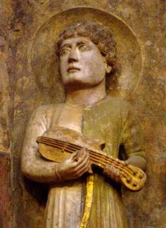 An example of the shallow bodied, spade-shaped instrument primarily found in Italy, detail of one of King David's musicians, by Benedetto Antelami, after 1196. Baptistery, Parma, Emilia-Romagna, Italy (photo: A. Margerum 2006)