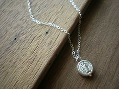 Hey, I found this really awesome Etsy listing at https://www.etsy.com/listing/75955376/vaticano-silver-rosary-necklace-with-st
