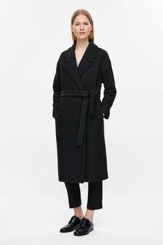 COS image 1 of Belted wool coat in Black