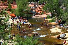 Slide Rock, Arizona    Where: Sedona, Arizona    On hot summer days, Sedona's Slide Rock transforms into a literal sea of people, some vying for turns down the sloping 80-foot-long sandstone-carved waterway, others cooling off in the creek's shallow stretches or boulder jumping into its deeper pools. Slide Rock is within the larger Slide Rock State Park.  More Info: www.azstateparks.com    Photo Caption: Slide Rock State Park, just north of Sedona    Photo by bill85704/Flickr.com