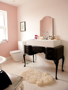 Fancy sink and pink bathroom