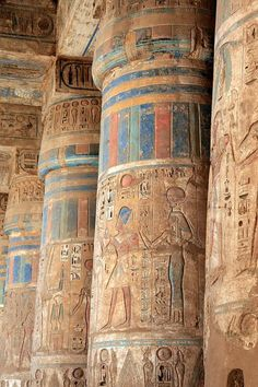 Painted Closed (bud) Style Capitals on Papyriform Columns in the peristyle hall of the Second courtyard at Medinet Habu. (Mortuary Temple of Ramesses III) Thebes, West Bank (Luxor) Egypt.
