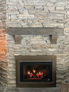 Outstanding small living room designs are available on our web pages. Read more … – Stone fireplace living room Rustic Fireplace Mantle, Grey Stone Fireplace, Reclaimed Wood Mantel, Stacked Stone Fireplaces, Wood Mantels, Home Fireplace, Living Room With Fireplace, Fireplace Design, Fireplace Ideas