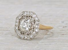 Vintage Edwardian ring made in platinum and gold centered with a 1.53 carat GIA certified old European cut diamond with I color and VS2 clarity. Accented with old European cut diamonds. Signed Tiffany & Co. Circa 1910