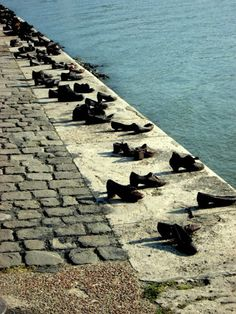 Holocaust Memorial on the Danube, Budapest, Hungary***The Shoes on the Danube Promenade is a memorial concept by Can Togay and the sculptor Gyula Pauer on the bank of the Danube River in Budapest. It honors the Jews who were killed by fascist Arrow Cross militiamen during World War II. They were ordered to take off their shoes, and were shot at the edge of the water so that their bodies fell into the river and were carried away. **Photo: T Hulswit ,August 2012**