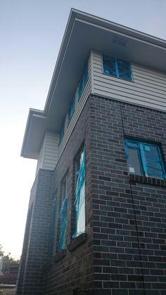 Blue steel flash bricks and surfmist cladding
