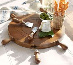 (Angela: imagine this as a table top in a boys room.) All aboard the patio party! A functional ship wheel for serving charcuterie makes for great serving decor! Ship Wheel, Summer Barbecue, Serving Platters, Pottery Barn, A Table, Dinnerware, Dining, Housewarming Gifts, Hostess Gifts