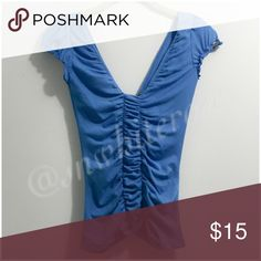 Romantic Blue Top Romantic Blue Top. Cap sleeves with feminine ruching and ruffle details. Ruching down the front and back center. Pre-loved. May vary from actual color due to camera and lighting. Please make all inquires and requests for additional pics prior to purchase. Tops