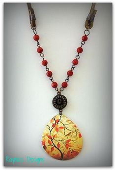 Decoupage paper to stone pendants you aren't loving anymore. Great way to upcycle an old piece of jewelry.   Fall Sunset by RaynasDesigns on Etsy