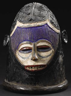 African: , Igala (Nigeria). Helmet Mask, Egwu Agba. Wood, pigment.Height: 12 ¼ inches Width: 9 3/8 inches Depth: 10 ¾ inches. ...