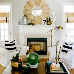 striped pillows, sunburst mirror, pharmacy lamp, slipcover, chairs, bamboo shades, baskets