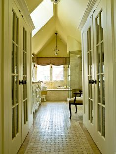 HALLWAY – English Cottage Style Graces a Home Bathed in Light  Starting with a bare lot, a downsizing Illinois couple builds a fitting home that welcomes the sun everywhere you turn