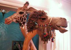 Needle felted giraffe and camel masks by Stefanie Buss.