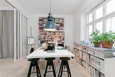 Look at all of those books.  Oh the space for them...and still so unobtrusive of the work space.  Really nice!