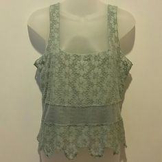 Free People sheer top INTIMATES Free People sheer lacey top. In a dark mint green. Lacey. Different texture lace mid way on shirt. Gently used. Free People Tops Tank Tops