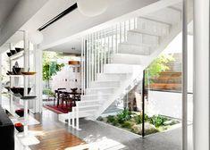 Modern droomhuis dat bestaat uit drie opgestapelde kubussen - Roomed