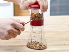 Go nuts chopping pecans, almonds and more for salads and desserts with this 1.5-cup nut chopper.