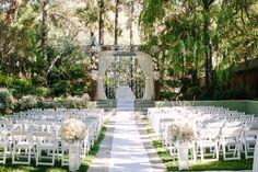 outdoor wedding ceremony / altar / isle deco
