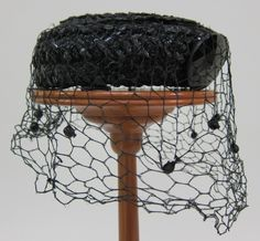"""Lacquered black straw pillbox hat 