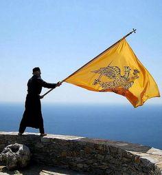 Father Joseph waving a byzantine flag in the Skete of Saint Minas, Mount Athos, Greece | by Nikos1933