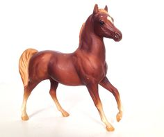 Collected Breyer horses with my friend back in the day. Pretty sure we had this one (and about 20-30 more) - vintage 1970s/1980s Breyer horse sorrell color stallion