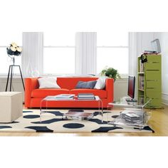 Love the lamp and the orange couch. Bold pops of color make me happy!