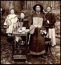 A GENIAL OFFICIAL OF INTERIOR CHINA -- A Naval Mandarin and Admiral of the River Fleet with his Wife and Daughter in KINKOW Photographed by JAMES RICALTON in 1900 during the Boxer Rebellion. The full stereoview is seen here : www.flickr.com/photos/24443965@N08/3490090978/ Chinese Culture, Chinese Art, Old Pictures, Old Photos, Vintage Photographs, Vintage Photos, Turandot Opera, Boxer Rebellion, China People