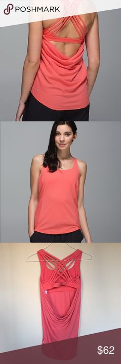 Lululemon Wild tank size 6 in atomic coral Lululemon wild tank size 6. Color: atomic color.   High low style with build in criss cross bra.  Only washed as instructed. One of my favorite tanks but lost weight and it's now too big! Great condition. lululemon athletica Tops Tank Tops